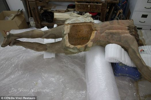 Restorers of an 18th century wooden statue of Jesus Christ have reportedly found a calligraphed note that a priest hid in the Messiah's rear end