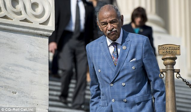 Defiant: Conyers, pictured on November 3 outside the Capitol, has denied any wrongdoing and said through his lawyer on Thursday that he has no intention to vacate his elected post