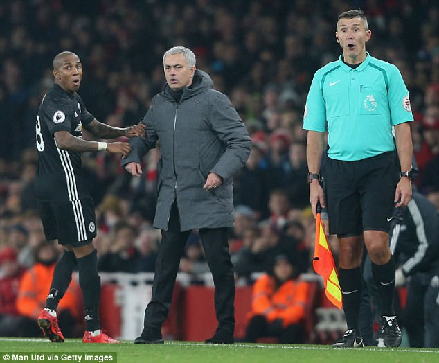 Ashley Young (left) tells manager Jose Mourinho that Paul Pogba is about to be sent off