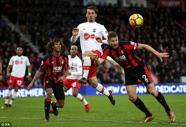 Manolo Gabbiadini (centre) battles for the ball withBournemouth's Simon Francis
