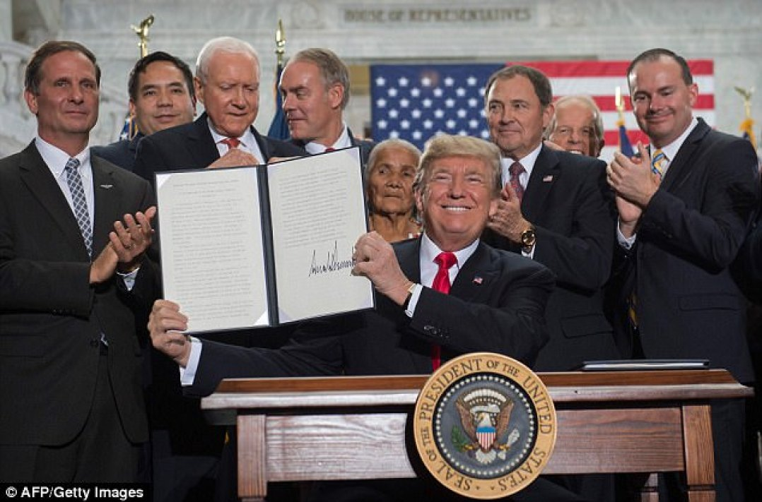 Trump's audience broke out into a brief chant of 'Four more years!' after he signed the national monument proclamation