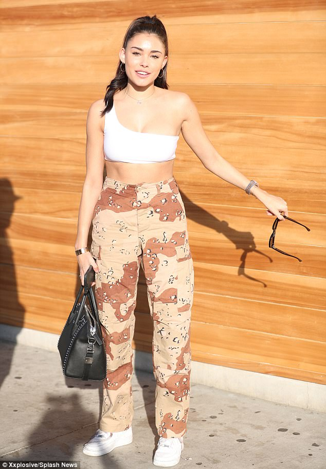 Ready for carbs?Madison Beer flaunted her taut tummy during lunch with pals at Italian diner Jon & Vinny's in Los Angeles on Monday