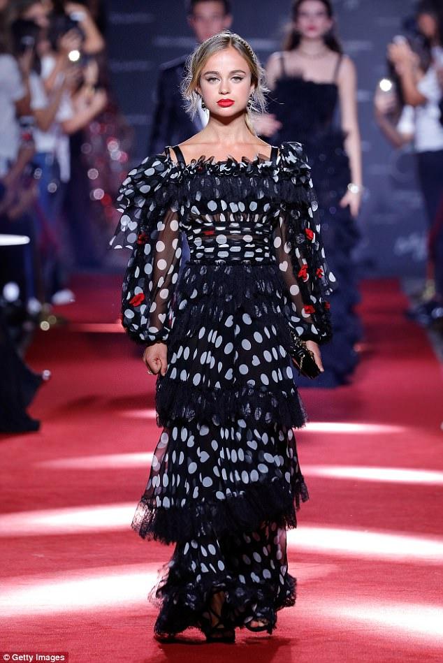 Amelia Windsor walks the runway at the Dolce & Gabbana secret show during Milan Fashion Week Spring/Summer 2018 at Bar Martini in September 2017