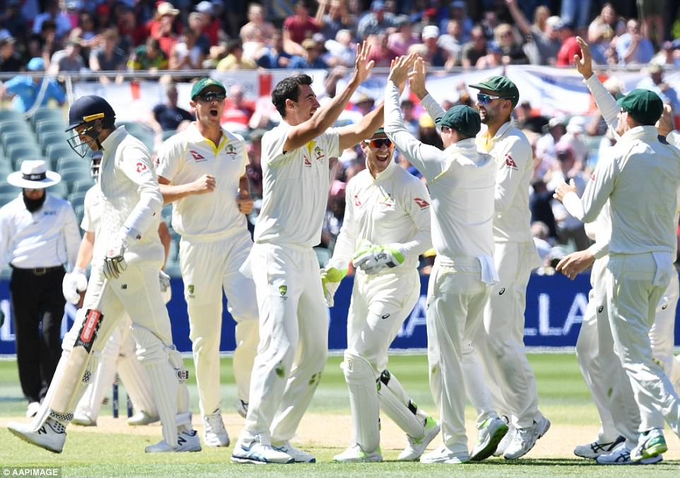 Mitchell Starc (centre) took five wickets as England were beaten by 120 runs in the second Ashes Test in Adelaide