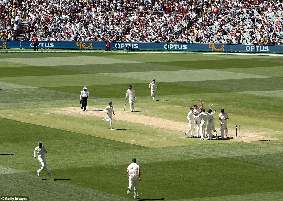 The Australian team rush to celebrate after Bairstow dragged on to leave his side facing a monumental task to save the series