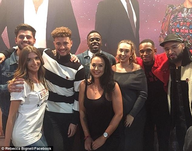 Front and centre: Rebecca (centre, in black) attended the X Factor only three weeks ago to support the band, despite taking a break from the artist in September