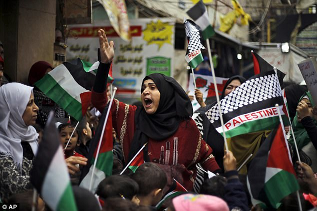 A woman chants slogans during a sit-in in the Bourj al-Barajneh Palestinian refugee camp in Beirut, Lebanon