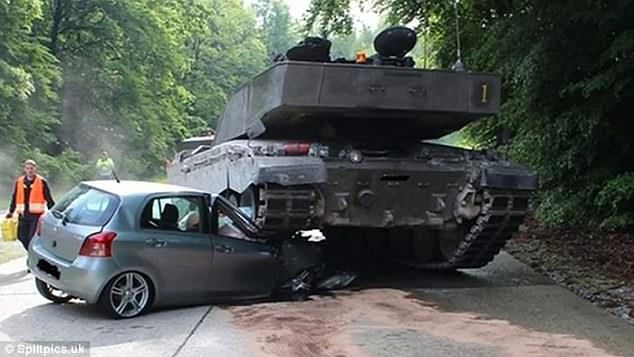 Crash, tank, wallop: What happens when an irresistible force meets a movable object? In this case a Volkswagen Polo gets crushed beneath a tanks' caterpillar track tires