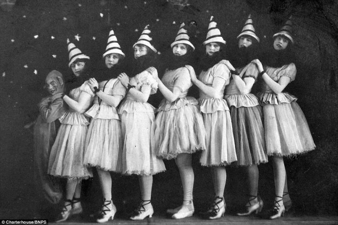 Young girls in full costume pose ahead of a performance of 'The Talk of the Town' in Bath, Somerset.The black and white cards were amassed by an elderly gentleman from Somerset who is now selling them for up to £5,000