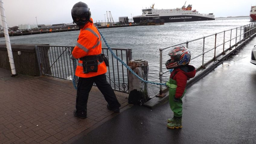 Fisherman Vojta Veszpremi attached his four-year-old son Tobias to a nylon rope to stop him being blown away by Storm Caroline in Stornoway on the Isle of Lewis. He said: 'I wanted to show Tobias some waves and make sure the storm would not blow him away or that we would get hurt by flying debris'