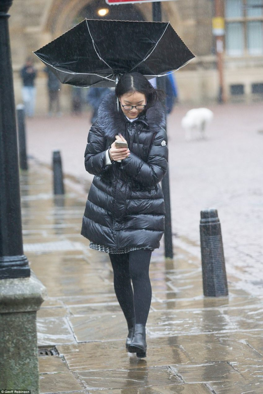 Many huddled under umbrellas and wrapped up warm as Cambridge saw wet and windy weather