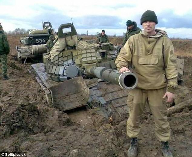 Say cheese: Despite finding his tank nearly completely submerged by dirt, this driver still found time to post of a picture