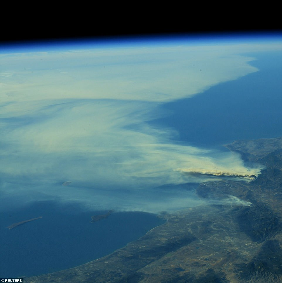This is the extraordinary view of the Southern California wildfires afforded by the International Space Station. The five massive blazes have scoured hundreds of square miles of the state, and forced 200,000 people from their homes
