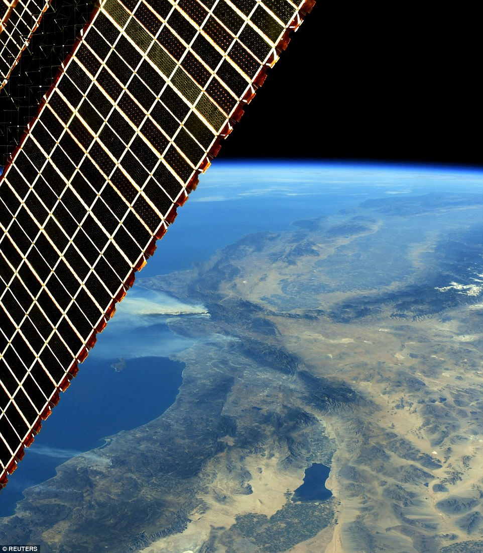 This shot shows one of the solar panels on the ISS, along with the wildfires far below. Much of Southern California is in 'extreme' danger of fires for the first time in history, the director at the California Dept of Forestry and Fire Protection said