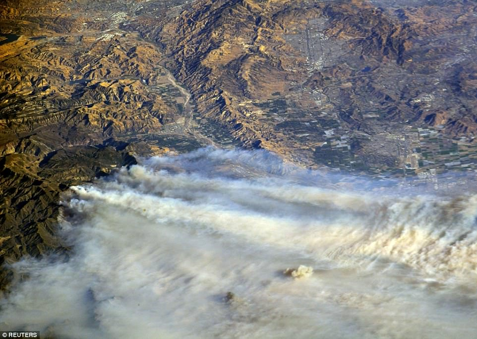 The blazes - the latest of which sprang up yesterday near Bel Air - have created vast plumes of smoke that have canopied nearby areas of the state. Experts say they're likely to get worse Thursday as 80mph Santa Ana winds push them on