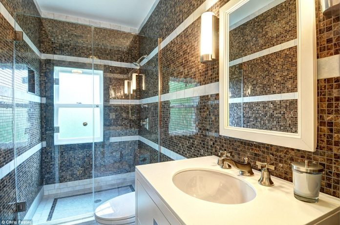 Busy pattern: This bathroom also features a large walk-in shower ad mosaic tiling