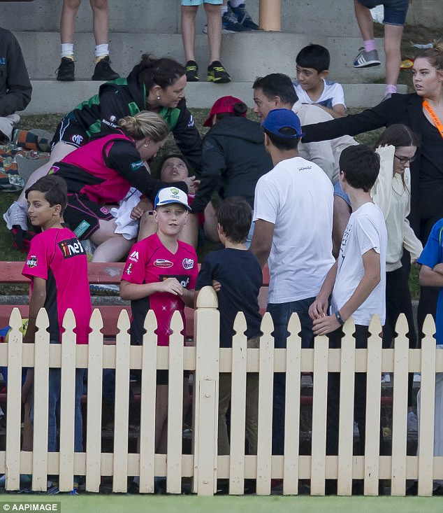 Cricket star Ellyse Perry has shown her class by racing over to check on a young boy struck in the head by a ball (pictured)