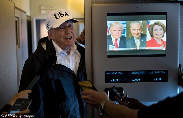 Trump told reporters in November (pictured) that he doesn't watch too much TV - but insiders say that he watches four-to-eight hours a day, from 5:30am to late at night