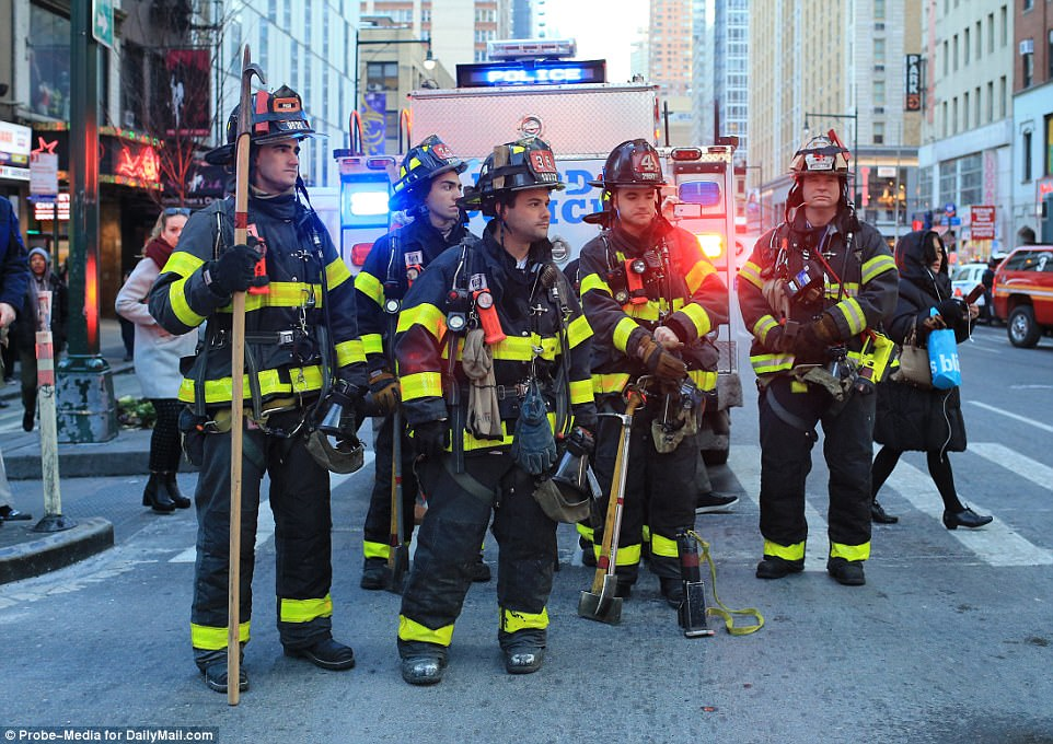 Firefighters at 42nd Street and 8th Avenue on Monday morning after an explosion in the Port Authority bus terminal transit tunnel