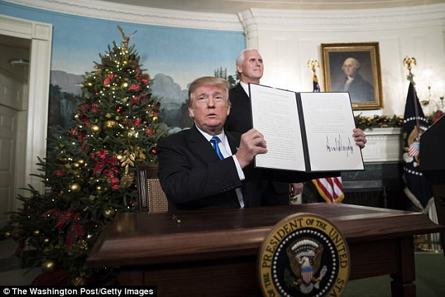 President Donald Trump declared earlier this month that the United States will now recognise Jerusalem as Israel's capital (pictured holding declaration), President Erdogan has stepped up his own pro-Palestine campaign