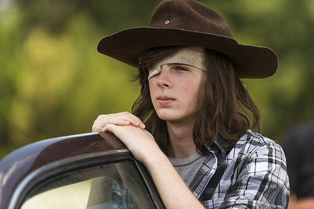 Shoulder length: The 18-year-old actor is shown in a season seven still as long-haired Carl