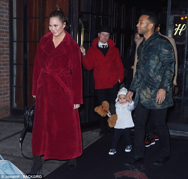 Family matters: John - who's an Emmy away from EGOT status - is currently in Manhattan with his pregnant wife Chrissy Teigen and their 20-month-old daughter Luna (pictured Saturday)