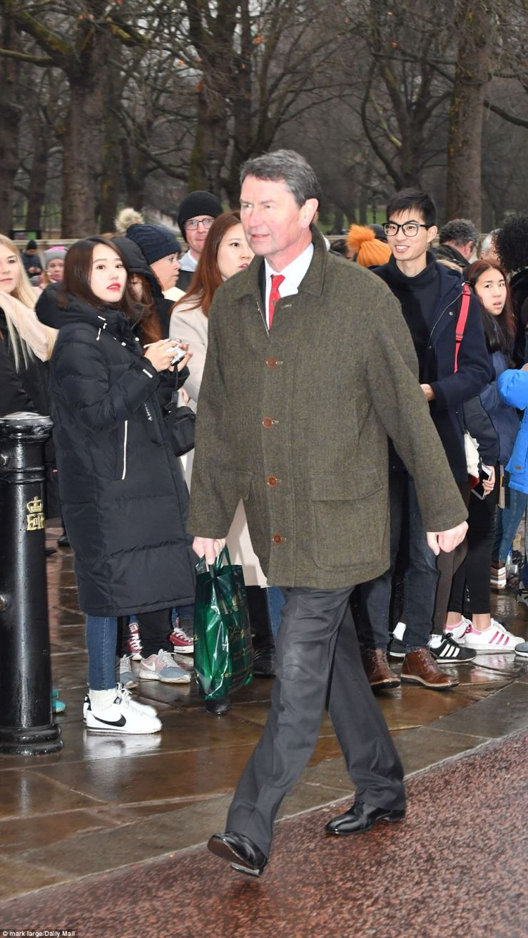Smartly dressed in a sharp suit with a crisp white shirt and a red tie, Sir Laurence, 62, clearly left some of the crowds a tad confused, with many unsure as to whether a royal would actually walk in the rain to the gates of Buckingham Palace