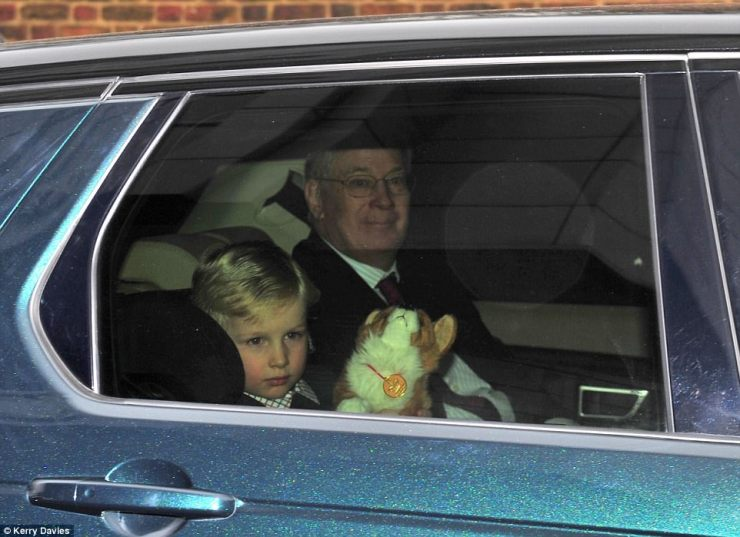 The Duke of Gloucester sat with his grandson Rufus who paid tribute to the Queen by clutching a corgi stuffed toy