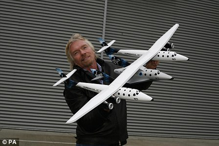 Richard Branson with the Virgin Galactic craft