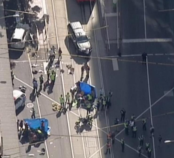 The heart of Melbourne's CBD is in lock down after the car ploughed down a number of shoppers and commuters (pictured)