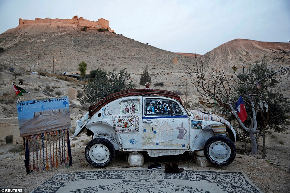 Mohammed Al-Malahim claims that his VW Beetle, pictured, is the world's smallest hotel