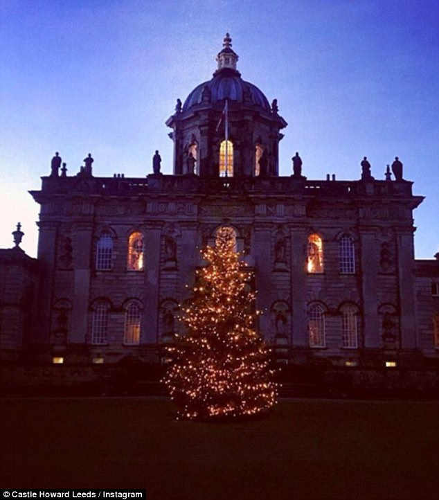 Crisp winter's night: This Christmas tree looks particularly festive against the castle