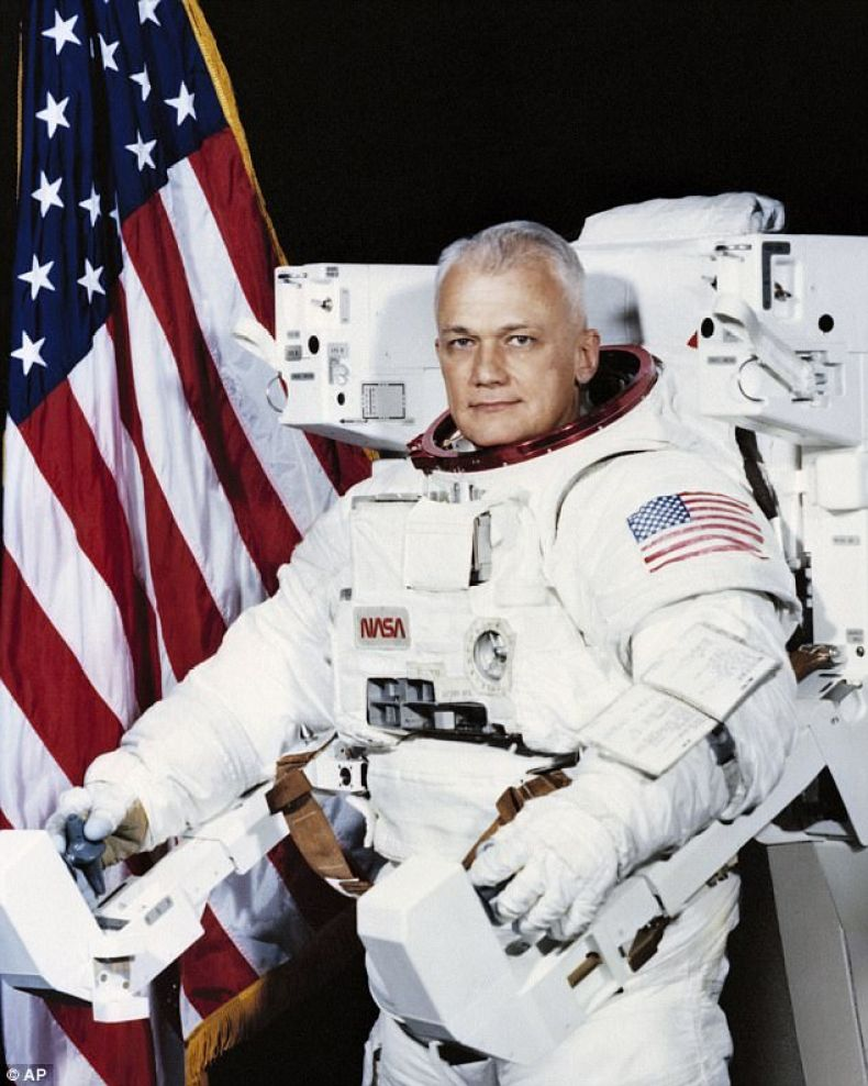 McCandless is seen here, wearing a Shuttle Extravehicular Activity (EVA) Suit with Manned Maneuvering Unit (MMU) in Houston in 1982