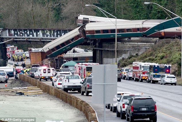 Video aboard the Amtrak train that derailed in Washington state has revealed that the engineer remarked about the train's speed six seconds before it went off the tracks south of Seattle,  (Pictured, the aftermath of the train collision)