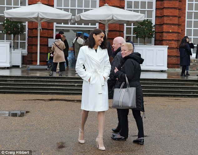 DOUBLE TAKE: Our Meghan turns heads outside Kensington Palace, as if these tourists had never seen a gorgeous, mixedrace, American actress-turned-Royal fiancee before