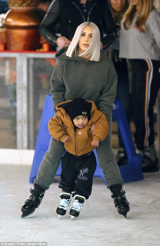 Aww:Kim Kardashian was overjoyed to spend the holiday season with her little ones, as she hit an ice rink with her son Saint and daughter North during a Christmas party in Thousand Oaks, California on Saturday