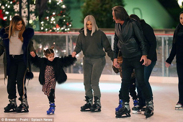 Pals: The whole family seemed to be enjoying their time on the ice