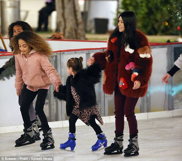 Friends! Little Penelope held on to Sophie Pippen's hand as her mother guided her on the ice