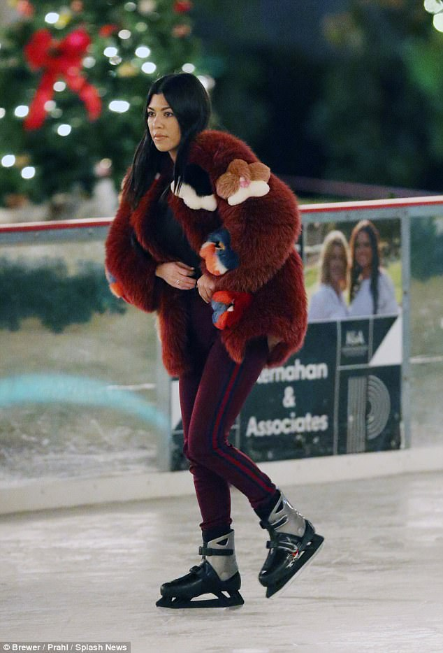 Cute! Sister Kourtney joined the group wearing an adorable fluffy rust-colored jacket covered with various vibrant shapes