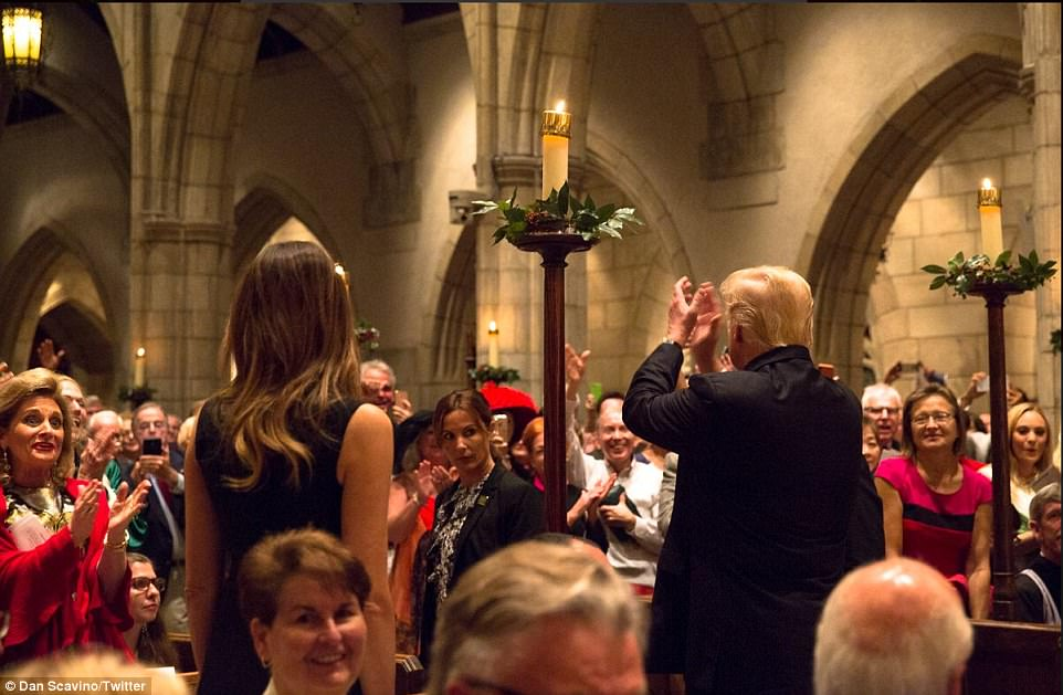 Dan Scavino, an aide to the president, tweeted that the president and first lady were 'greeted by stand[ing] ovation and cheers upon their arrival' in the church