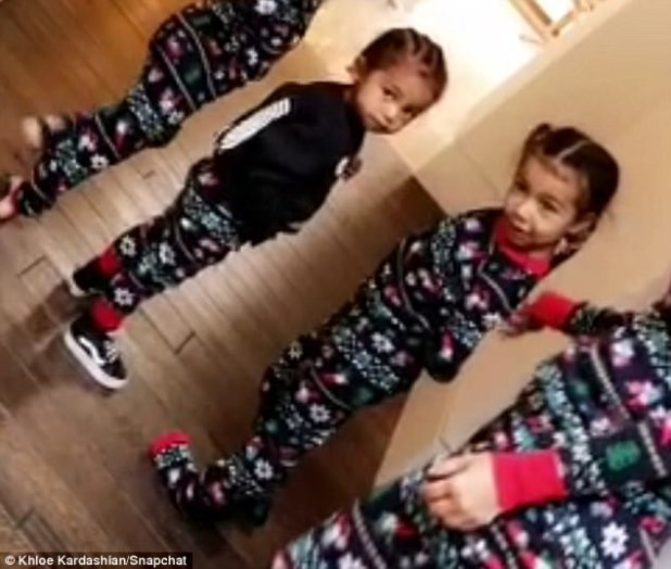 Cute for Christmas: Saint and his sister North were adorable on Christmas morning as they had fun at aunt Kourtney Kardashian's house