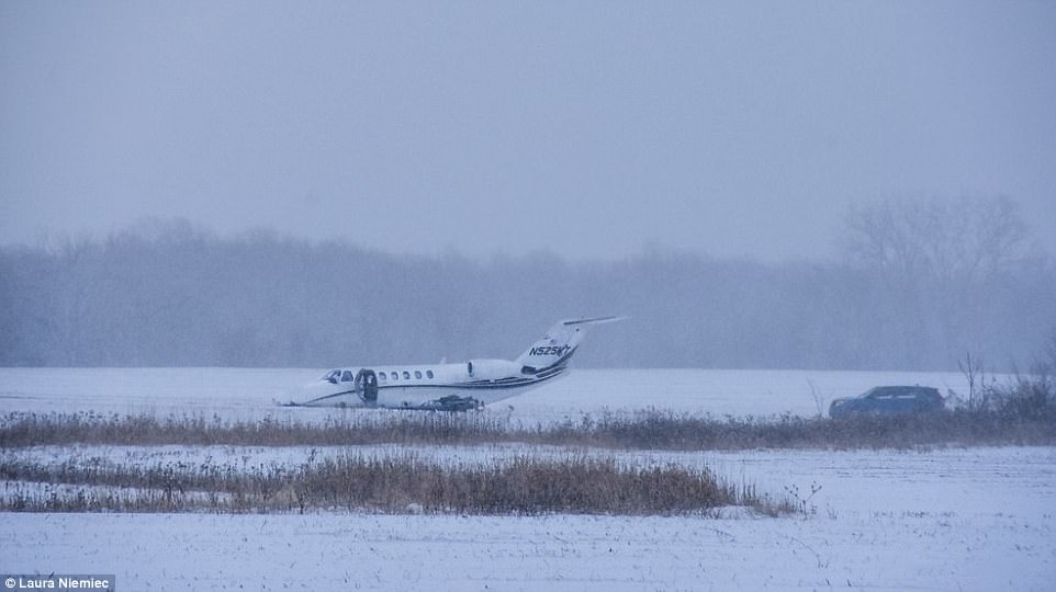 A small jet slid off the runway at Michigan City Municipal Airport in Indiana early Wednesday morning (scene above). It's located about 65 miles from Chicago