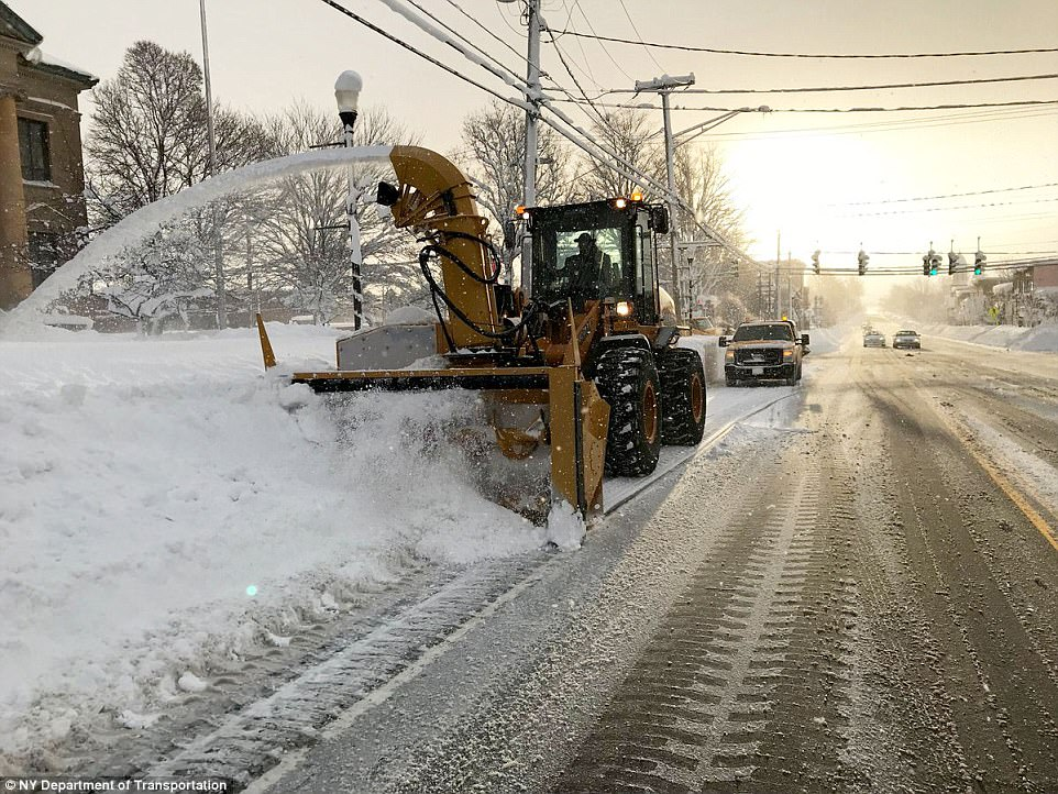 A snow blowing operation is pictured above along Routes 394 and 430 in Mayville in Chautauqua County, New York on Wednesday