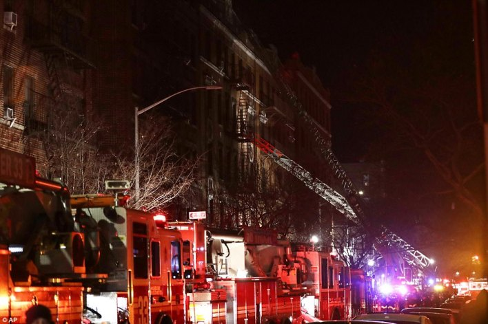 The Fire Department of New York says a blaze raging in a Bronx apartment building has killed at least 12 and seriously injured 15 people