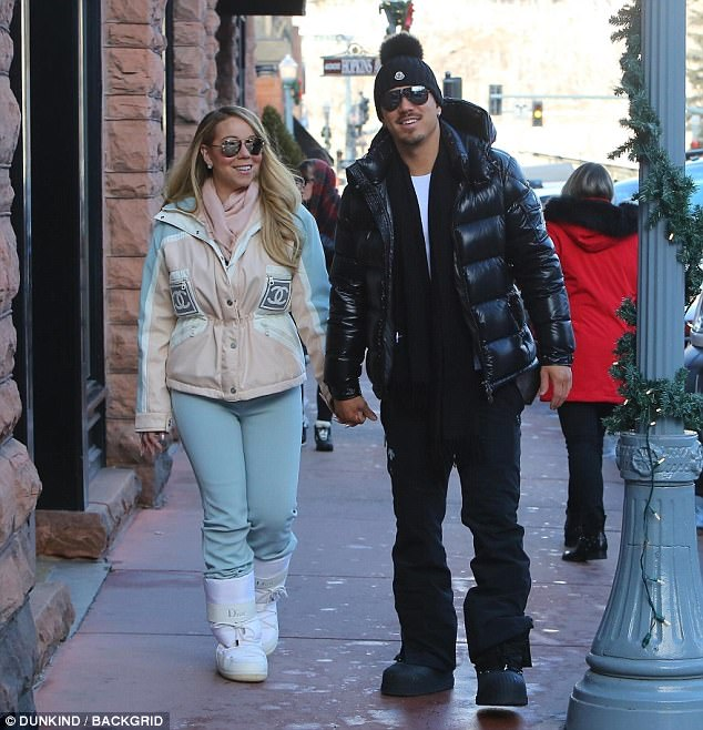 New flames: In a strange turn of events, the We Belong Together songstress is also vacationing in Aspen with her 34-year-old boyfriend Bryan Tanaka