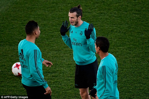 Welsh winger Gareth Bale shares a joke with Casemiro during the training session