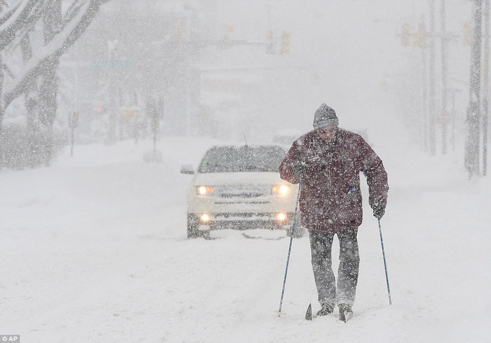 Timothy Gigone, 51, of Erie, Pennsylvania skis south on Sassafras Street near the intersection of West 14th Street on Saturday