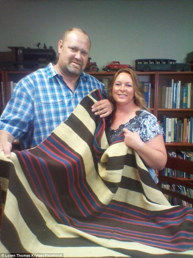 Loren Krytzer realized his grandmother's blanket (pictured, with wife Lisa holding it) could be worth something after watching Antique Roadshow and an identical one appeared