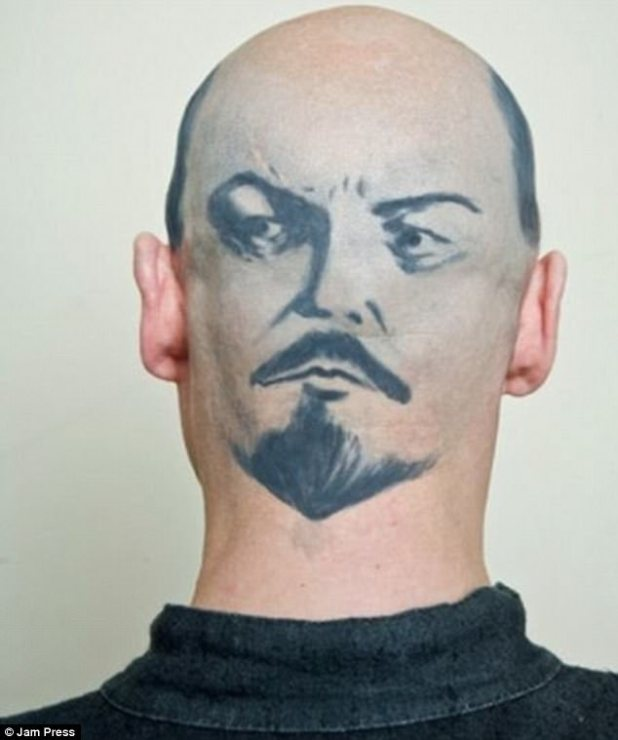 Taking two-faced to whole new meaning! One man got creative by having the face of fellow bald man Lenin tattooed on the back of his head