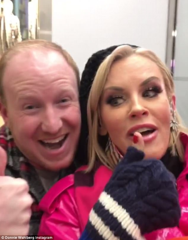 Thumbs up! Jenny McCarthy was keen to thank Gap store employee Tyler for letting her and husband Donnie Wahlberg keep warm in his closed store on New Year's Eve in New York